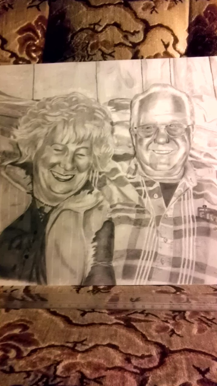 An elderly couple's portrait, finally complete.