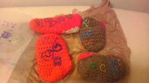 A failed attempt at cute puff paint designs for traction on crochet booties.