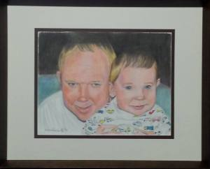 Finished and framed portrait of a deceased father and his son.