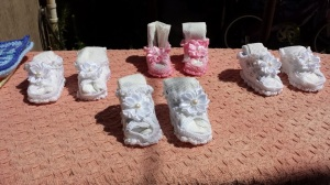 Using Hodge Podge's tutorial shared in the last post, I shaped these four sets of booties.